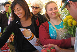 Shoppers buing fresh produce at the Farmers Market in downtown Salinas